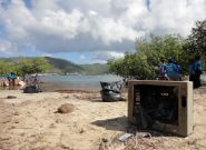 Young eco caregivers scrub polluted Tortola coastlines